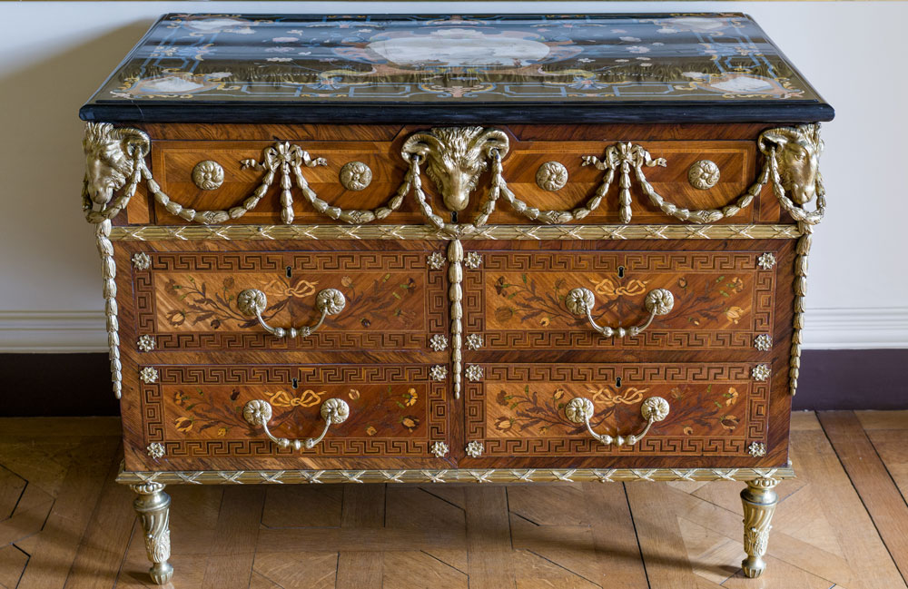 51 One of a pair of marquetry commodes attributed to Pierre Langlois. From the Woburn Abbey Collection